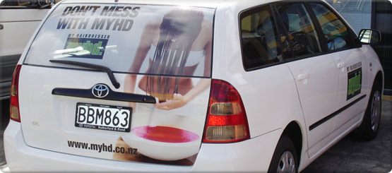 Vehicle signage and vehicle graphics